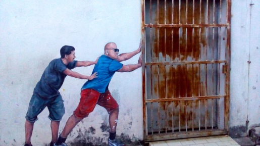 """Pushing the Gate"", George Town"